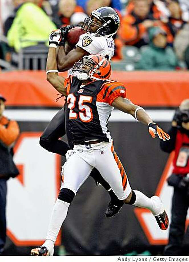CINCINNATI - NOVEMBER 30:  Mark Clayton #89 of the Baltimore Ravens catches a pass while defended by Jamar Fletcher #25 of the Cincinnati Bengals during the NFL game on November 30, 2008 at Paul Brown Stadium in Cincinnati, Ohio.  (Photo by Andy Lyons/Getty Images) Photo: Andy Lyons, Getty Images