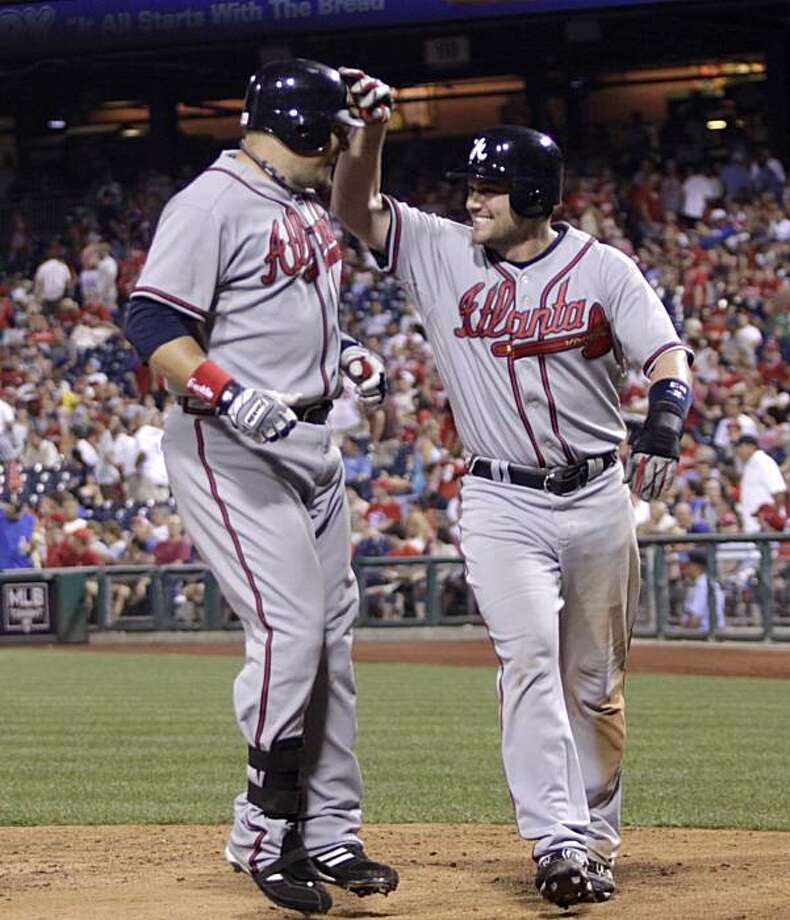 Atlanta Braves'  Eric Hinske,left and Matt Diaz celebrate after Hinske two-run home against the  Philadelphia Phillies in the eleventh inning of a baseball game Tuesday, July 6, 2010, in Philadelphia. Braves won 6-3. Photo: H. Rumph Jr, AP