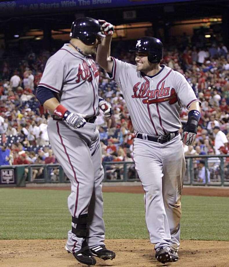 Atlanta Braves'  Eric Hinske,left and Matt Diaz celebrate after Hinske two-run home against the  Philadelphia Phillies in the eleventh inning of a baseball game Tuesday, July 6, 2010, in Philadelphia. Braves won 6-3. Photo: H. Rumph Jr, AP