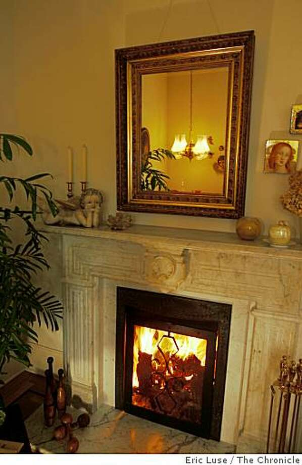 sigstyle_sales_walters_129_el.jpg The marble  fireplace  was a gift by Sales  which has owl shaped faces for the firebox holder.Jim and Dotty Walters home in Healdsburg rebuilt by Enid Sales, first female contractor in the state.  Eric Luse / The ChroniclePhoto taken on 1/7/08, in Sonoma County, CA, USAName cq by sourceJim and Dotty WaltersEnid Sales Photo: Eric Luse, The Chronicle