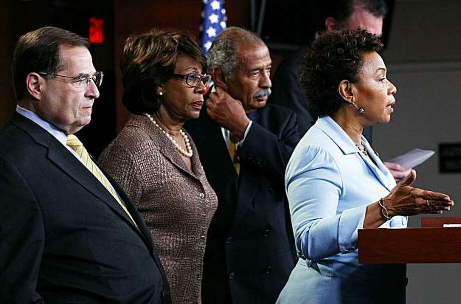 """WASHINGTON - JULY 01:  Rep. Barbara Lee (D-CA) (R) answers questions during a news conference on Capitol Hill with (L-R) Rep. Jerrold Nadler (D-NY), Rep. Maxine Waters (D-CA) and House Judiciary Committee Chairman Rep. John Conyers (D-MI) July 1, 2010 inWashington, DC. Conyers and other representatives discussed """"Opposition to War Funding in the Supplemental Appropriations Act of 2010 and the direction of U.S. foreign policy in Afghanistan."""" Photo: Win McNamee, Getty Images"""