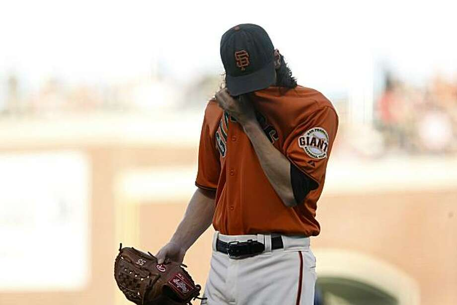 San Francisco Giants pitcher Tim Lincecum walks to the dugout at the end of the first inning allowing  Oakland Athletics Ryan Sweeney to scores,Friday June 11, 2010, in San Francisco, Calif. Photo: Lacy Atkins, The Chronicle