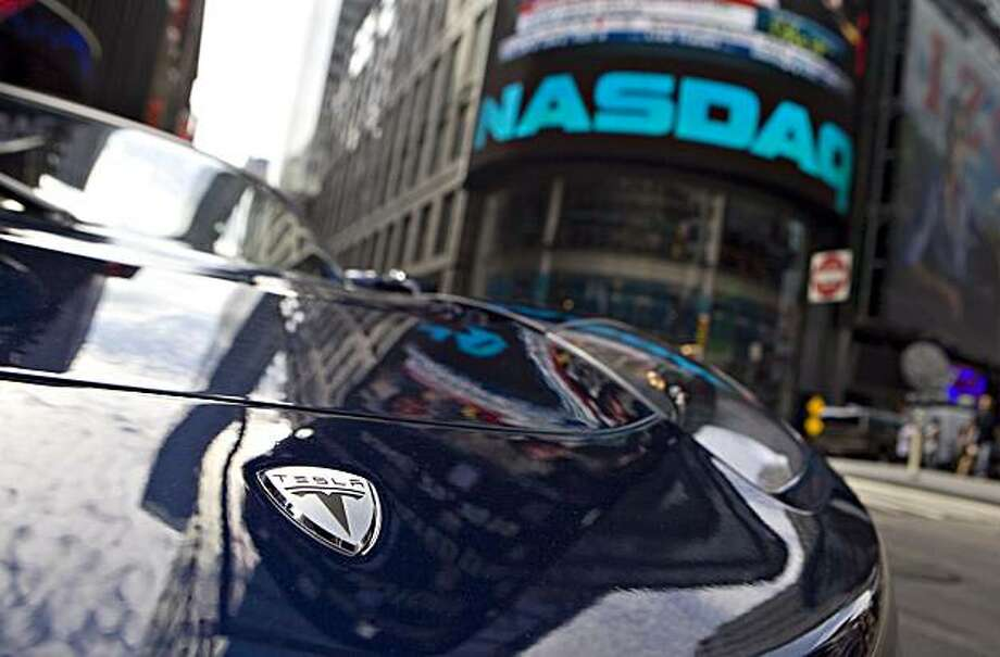 A Tesla Roadster electric car sits on display outside the Nasdaq Marketsite in New York, U.S., on Tuesday, June 29, 2010. Tesla Motors Inc., the electric car company that hasn't posted a profit, raised $226 million selling shares above its forecast price range in the first initial public offering of a U.S. automaker in a half century. Photographer: Daniel Acker/Bloomberg Photo: Daniel Acker, Bloomberg