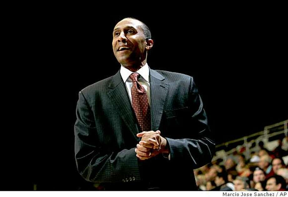 Stanford head coach Johnny Dawkins smiles as his team plays Colorado in the first half of a game in Stanford, Calif., Saturday, Nov. 29, 2008. Photo: Marcio Jose Sanchez, AP