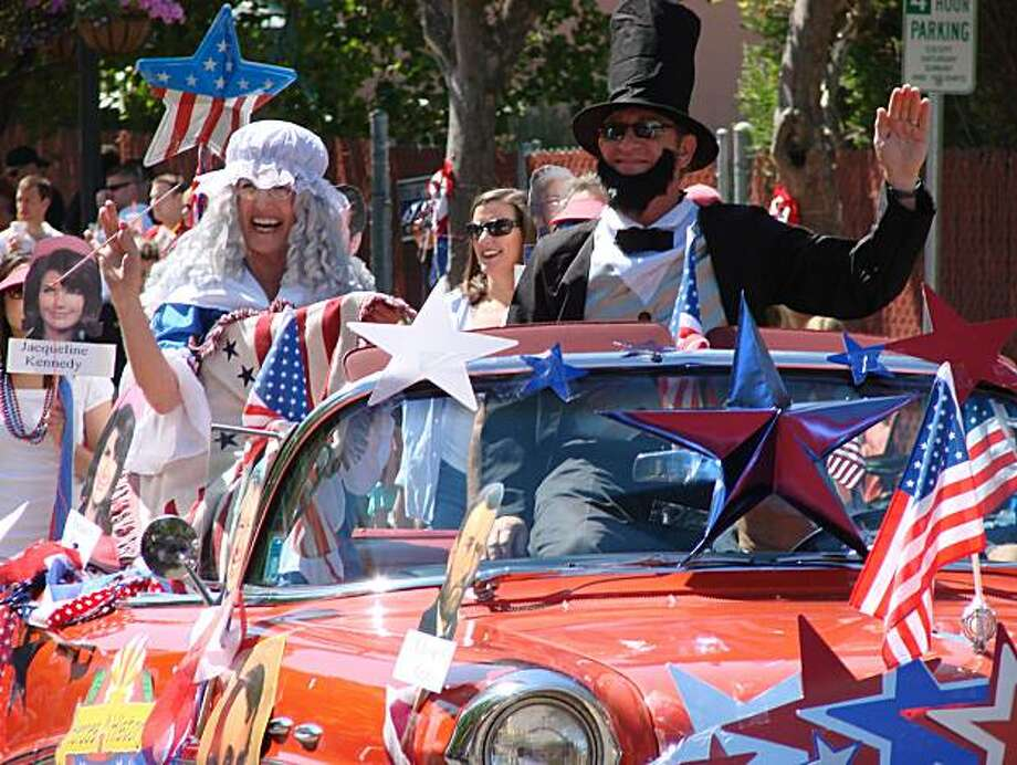 Pam Camras as Betsy Ross and Keith Miller as Abe Lincold in the 2009 Orinda Chamber of Commerce entry in the July Fourth parade. This year's parade is at 11 a.m. today from the orinda Theater to  Orinda Community Center Park. Photo: Sally Hogarty
