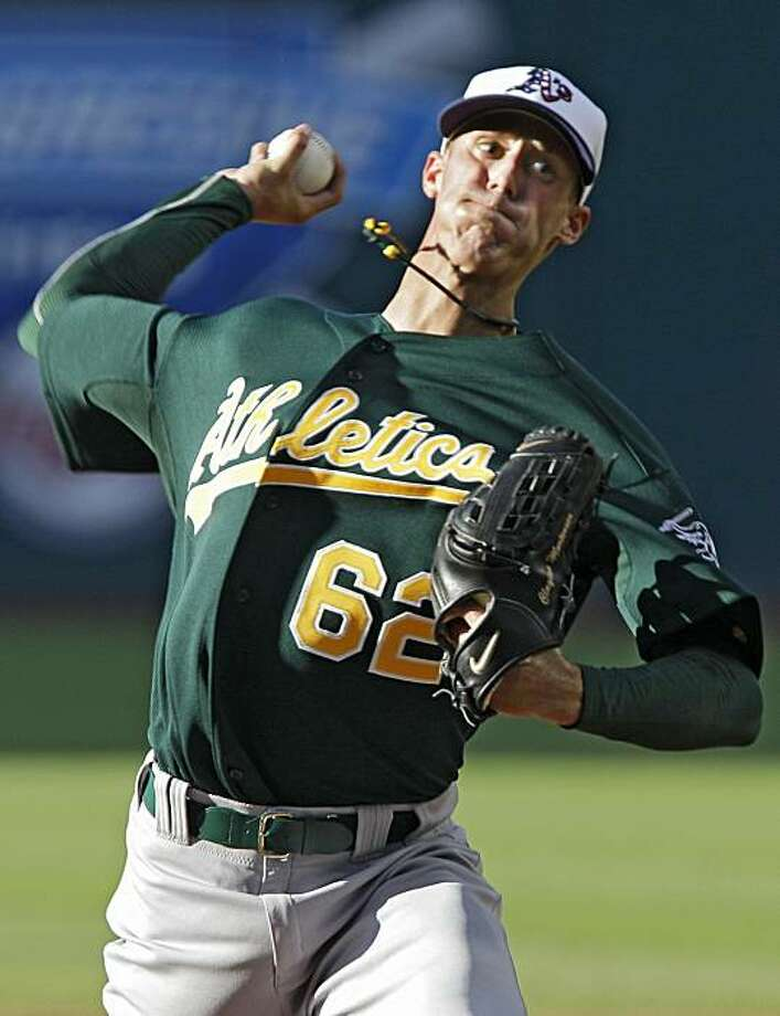 Oakland Athletics' Clayton Mortensen pitches against the Cleveland Indians in the first inning of a baseball game Saturday, July 3, 2010, in Cleveland. Photo: Mark Duncan, AP