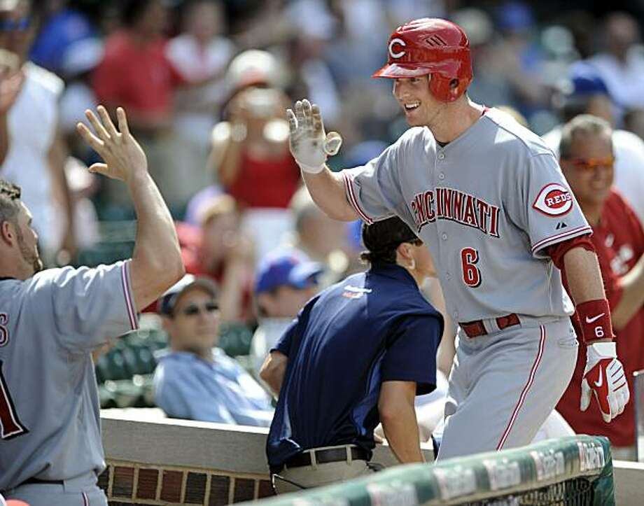 Cincinnati Reds' Drew Stubbs right, celebrates with teammate Jonny Gomes after hitting his third home run of the day against the Chicago Cubs in the ninth inning of a baseball game in Chicago, Sunday, July 4, 2010. Photo: Paul Beaty, AP