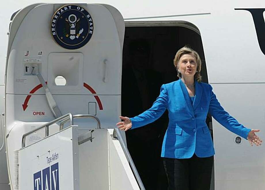US Secretary State Hillary Clinton gestures while exiting her airplane upon arrival to Tbilisi on July 5, 2010. Clinton was to wrap up a tour of eastern Europe and the Caucasus with a visit to Georgia, where she is expected to reassure President Mikheil Saakashvili of continued US support. Photo: Vano Shlamov, AFP/Getty Images