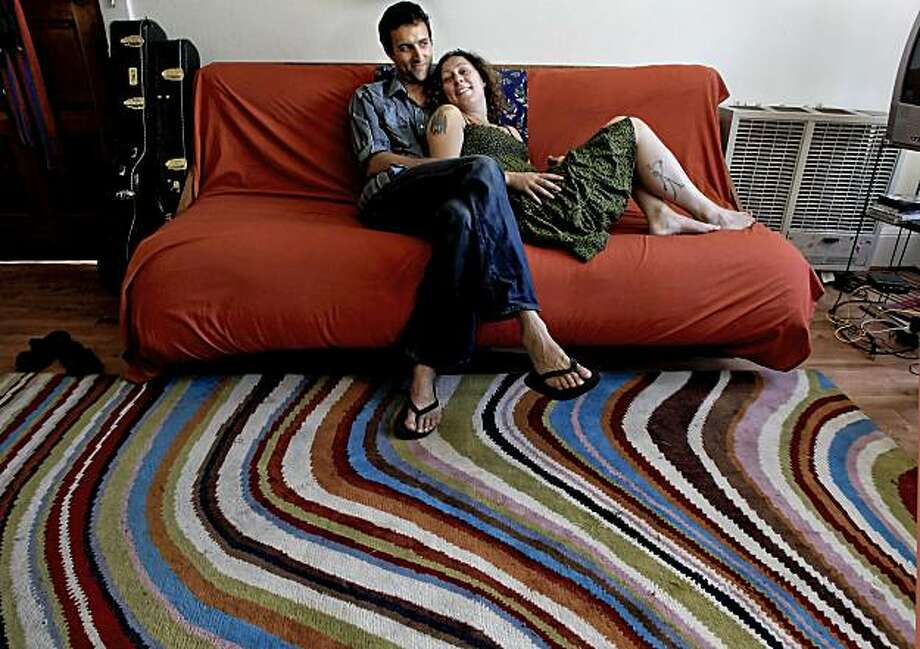 Erik Yates and Emily Wilsoncroft  at their home in Oakland, Ca. on Tuesday June 29, 2010. On the Couch column features the couple. Photo: Michael Macor, The Chronicle