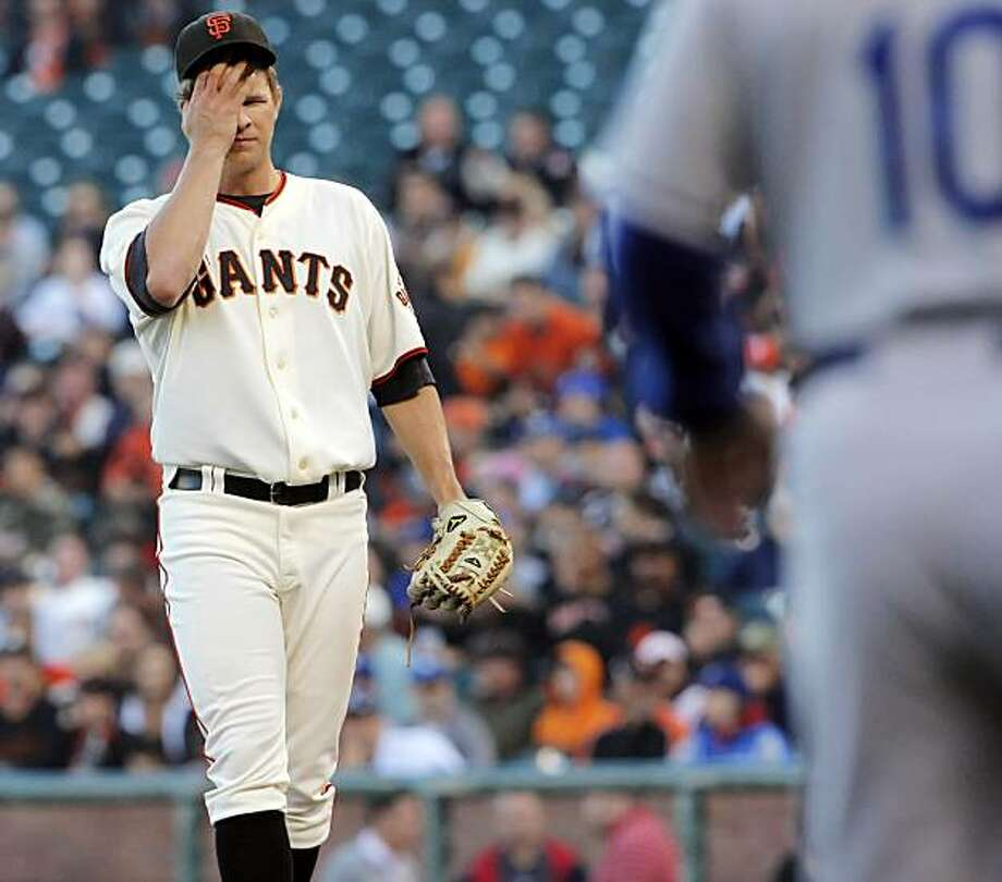 Matt Cain wipes his brow in the first inning. The San Franciso Giants played the Los Angeles Dodgers at AT&T Park in San Francisco, Calif., on Tuesday, June 29, 2010. Photo: Carlos Avila Gonzalez, The Chronicle