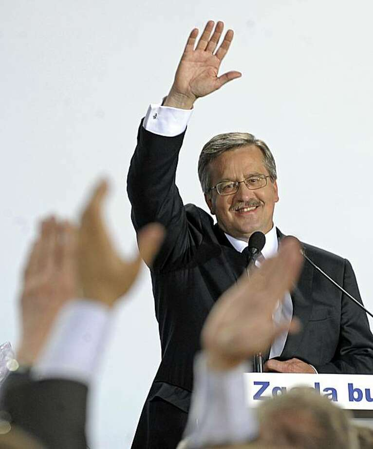Parliament Speaker, acting president and presidential candidate Bronislaw Komorowski reacts after exit polls for the early presidential elections in Warsaw on July 4, 2010. Polish conservative opposition leader Jaroslaw Kaczynski congratulated the governing liberals' candidate Bronislaw Komorowski after exit polls showed he had won the presidential vote. Photo: Janek Skarzynski, AFP/Getty Images