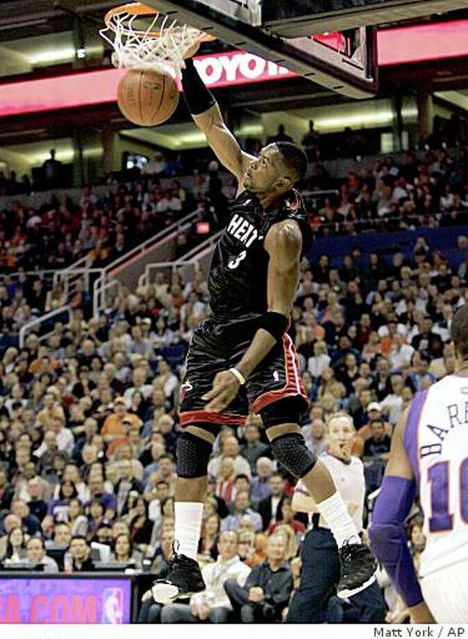 Miami Heat guard Dwayne Wade scores against the Phoenix Suns during the second quarter of an NBA basketball game Friday, Nov. 28, 2008, in Phoenix. (AP Photo/Matt York) Photo: Matt York, AP