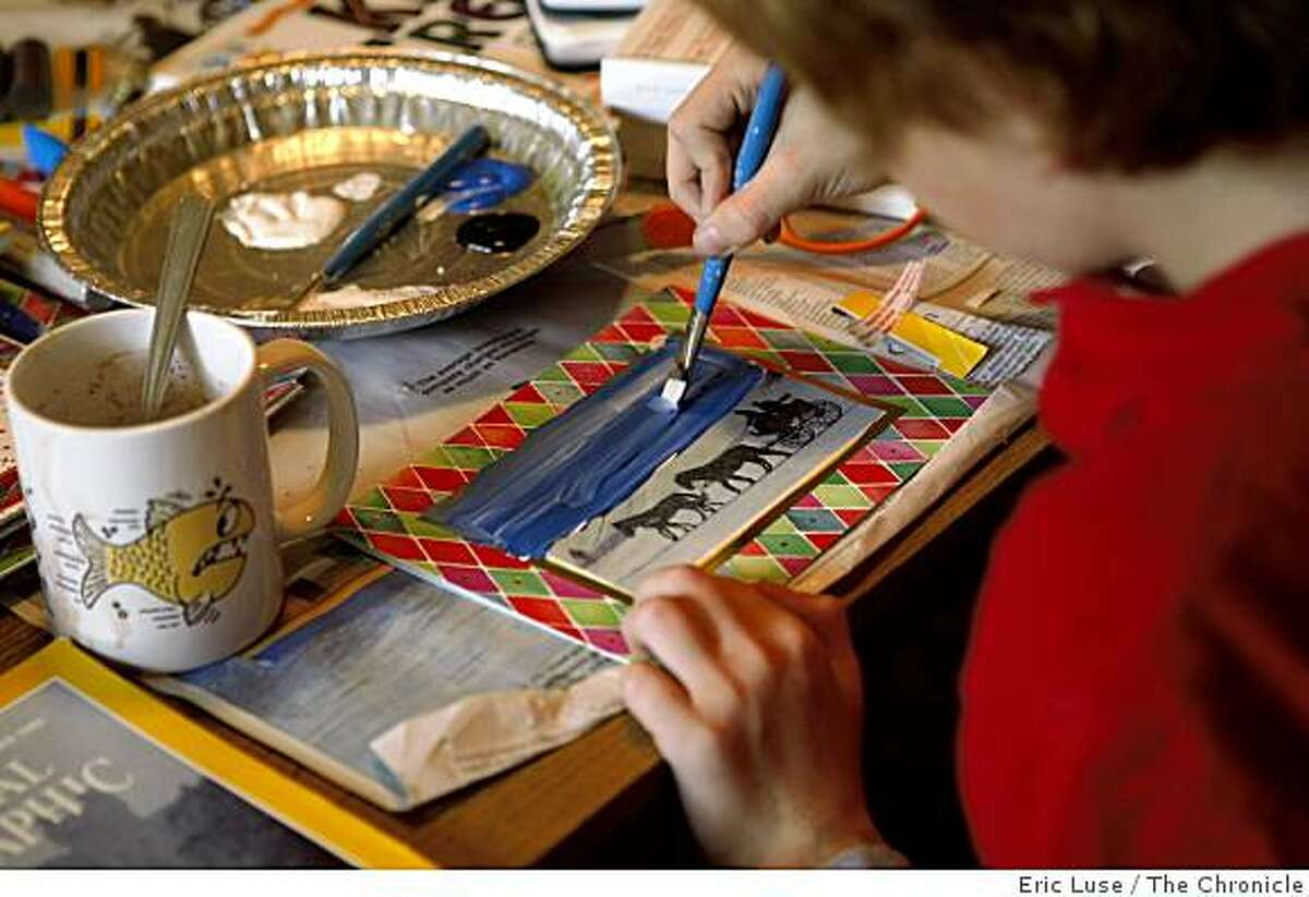 Coby Muchin,10, adds some paint and sparkle to Christmas Card during a get together to make homemade gifts for the Holidays photographed in Oakland on Wednesday, November 19, 2008.