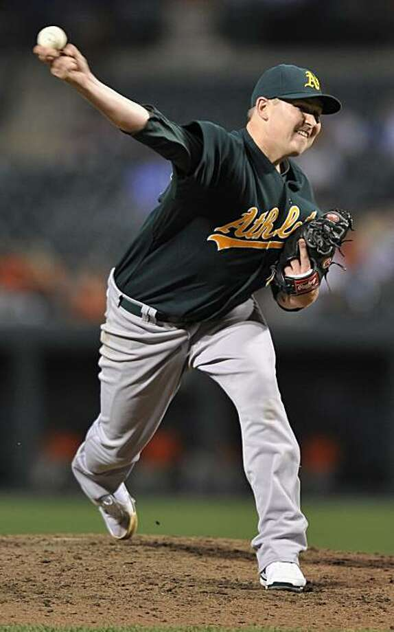 Oakland Athletics pitcher Trevor Cahill delivers against the Baltimore Orioles in the sixth inning of a baseball game Thursday, July 1, 2010, in Baltimore. The Athletics won 8-1. (AP Photo/Gail Burton). Photo: Gail Burton, AP
