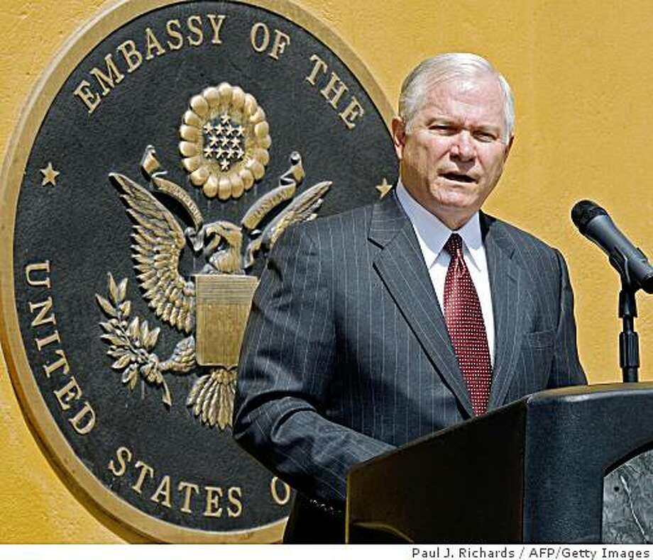 (FILES) Photo dated September 17, 2008 shows US Defense Secretary Robert Gates delivering a speech at the US Embassy in Kabul. Gates has agreed to stay in his job when president-elect Barack Obama takes office in January, with an announcement expected next week, reports said on November 25, 2008. Politico.com, ABC News and CNN said the highly regarded Gates would stay at the Pentagon at least for president Obama's first year and execute the Democrat's signature policy of withdrawal from Iraq.  AFP PHOTO/FILES/POOL/Paul J. RICHARDS (Photo credit should read PAUL J. RICHARDS/AFP/Getty Images) Photo: Paul J. Richards, AFP/Getty Images
