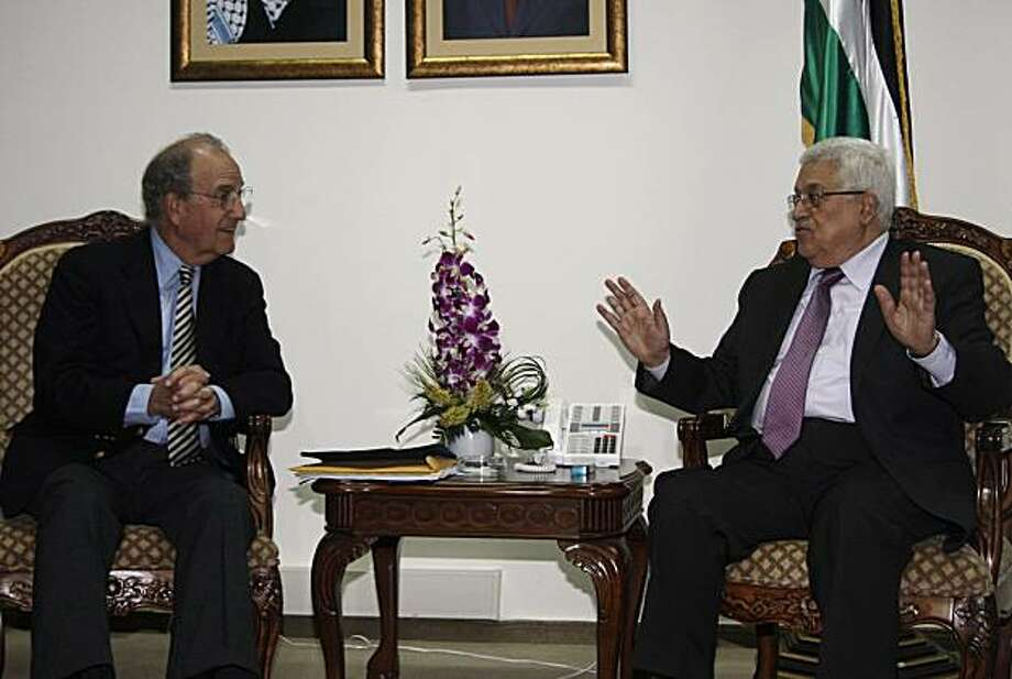 US Mideast envoy George Mitchell, left, speaks with Palestinian President Mahmoud Abbas during their meeting at Abbas' residence in the West Bank city of Ramallah, Thursday, July 1, 2010. Israeli newspapers reported on Thursday that Abbas has held a rareinterview with Israeli reporters where he tired to blunt the impression in some Israeli circles that Israel has no partner in peace talks. Photo: Mohamad Torokman, AP