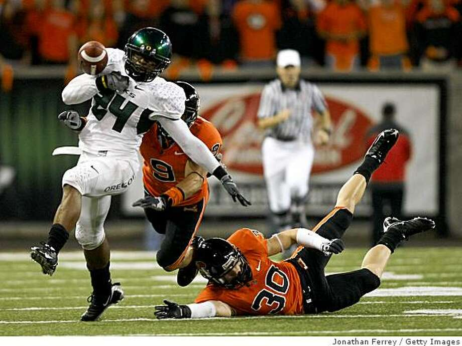 CORVALLIS, OR - NOVEMBER 29:  Jeremiah Johnson #24 of the Oregon Ducks bobbles the ball  as he runs for an 83 yard touchdown in the 2nd quarter against the Oregon State Beavers at Reser Stadium on November 29, 2008 in Corvalis, Oregon.  (Photo by Jonathan Ferrey/Getty Images) Photo: Jonathan Ferrey, Getty Images