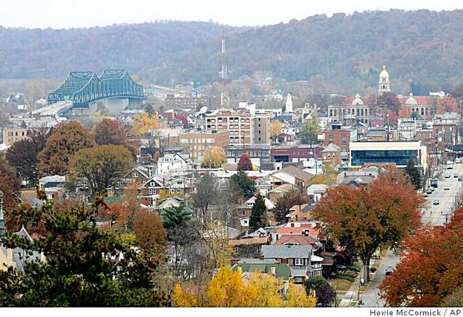 The City of Huntington, W. Va., is seen in an aerial view, Tuesday, Nov. 11, 2008. Nearly half the adults are obese, and Huntington leads in a half-dozen other measures of illness, too, including heart disease and diabetes. But many of the locals don't even know it. (AP Photo/Howie McCormick) Photo: Howie McCormick, AP
