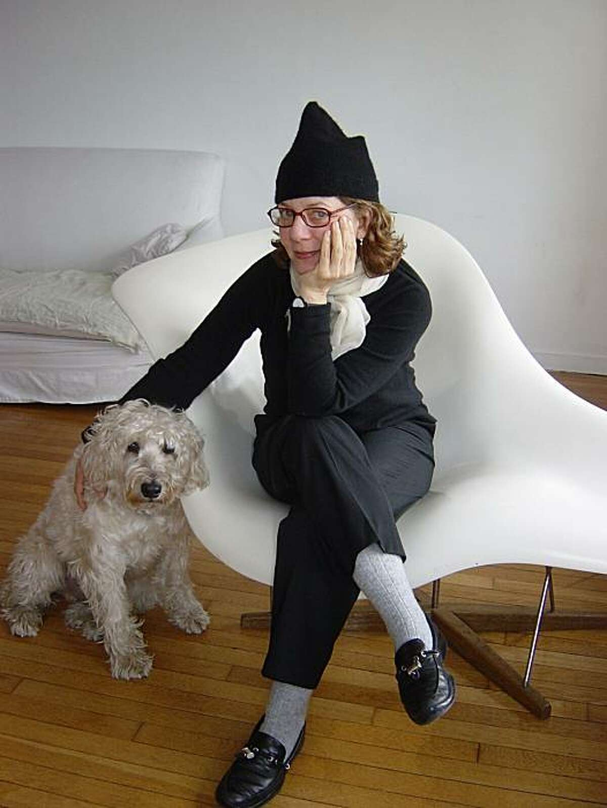 Portrait of New York artist, author and illustrator Maira Kalman with her dog