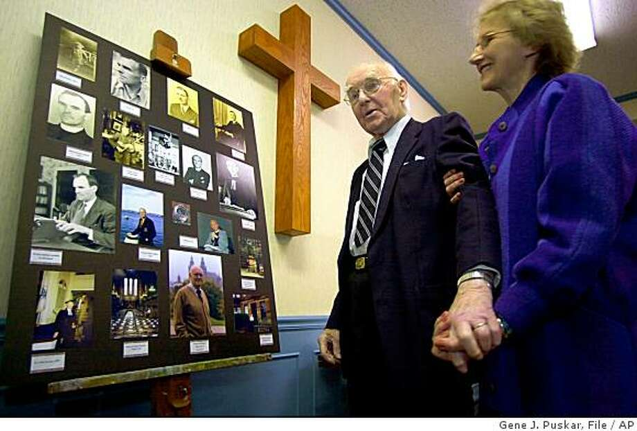 "** FILE **In this Feb. 4, 2004, file photo, Rev. George M. Docherty and his wife, Sue, look at a display of photos celebrating the retired minister's life, at Huntingdon Presbyterian Church in Huntingdon, Pa. Docherty, whose sermon before President Dwight Eisenhower helped push Congress to insert the words ""under God"" into the Pledge of Allegiance, has died. He was 97. (AP Photo/Gene J. Puskar, File) Photo: Gene J. Puskar, File, AP"
