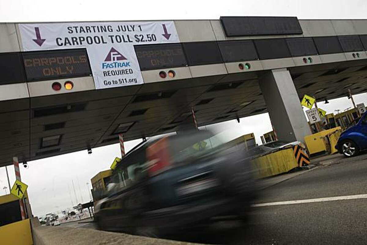 A sign announcing the July 1 toll increase is seen above the toll plaza in Oakland, Calif. on Friday June 25, 2010.