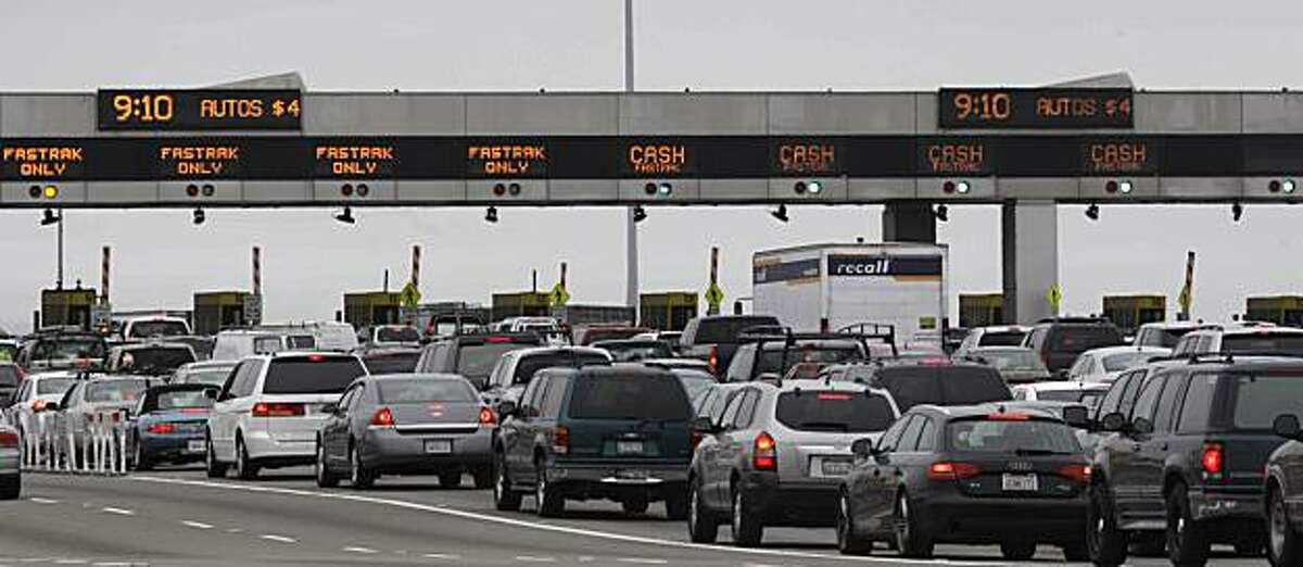 A clock mounted above the toll plaza shows the time and toll price as cars pass underneath in Oakland, Calif. on Friday June 25, 2010.