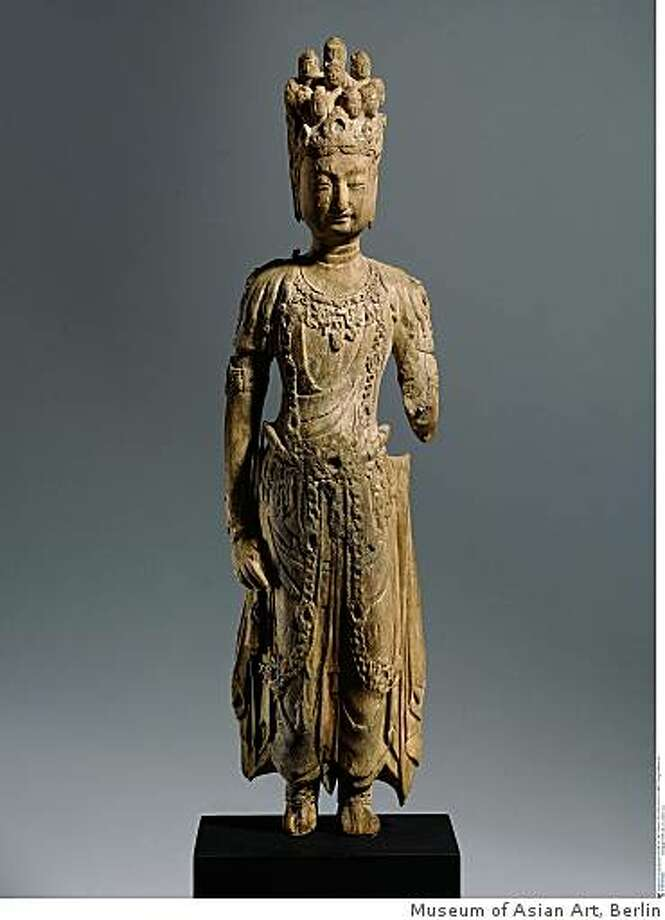 Statue of Eleven-Headed Avalokiteshvara, 7th c. A.D. wood sculpture, possibly from Tang Dynasty China. From Museum of Asian Art, Berlin Photo: Museum Of Asian Art, Berlin
