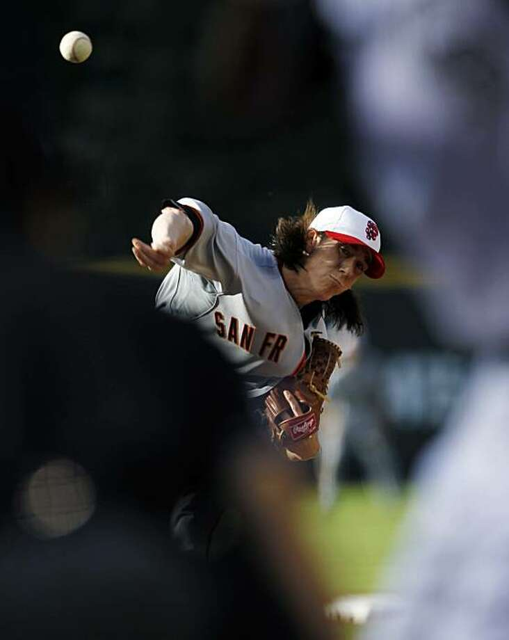 San Francisco Giants starting pitcher Tim Lincecum works against the Colorado Rockies in the first inning of a baseball game in Denver on Friday, July 2, 2010. Photo: David Zalubowski, AP