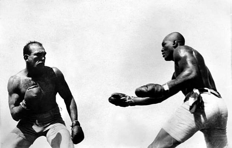 "In this photo taken July 4, 1910 and provided by the Nevada Historical Society, Jack Johnson, right, fights ""Great White Hope"" Jim Jeffries in Reno Nevada.  A century ago Johnson reached the pinnacle of his career when he defeated Jeffries in what was billed as the ""Fight of the Century."" One hundred years later fans of the legendary fighter are still seeking a posthumous presidential pardon for Johnson, saying that his later conviction for transporting a woman across state lines for immoral purposes wassteeped in racism. Photo: AP"