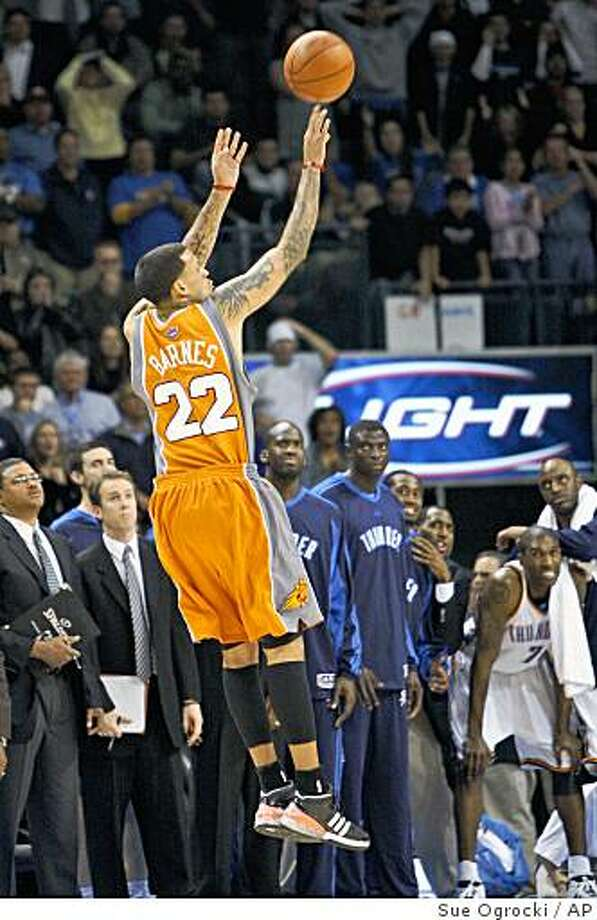Phoenix Suns forward Matt Barnes releases a 3-point shot from in front of the Oklahoma City Thunder bench in the fourth quarter of an NBA basketball game in Oklahoma City, Tuesday, Nov. 25, 2008. Phoenix won 99-98. (AP Photo/Sue Ogrocki) Photo: Sue Ogrocki, AP