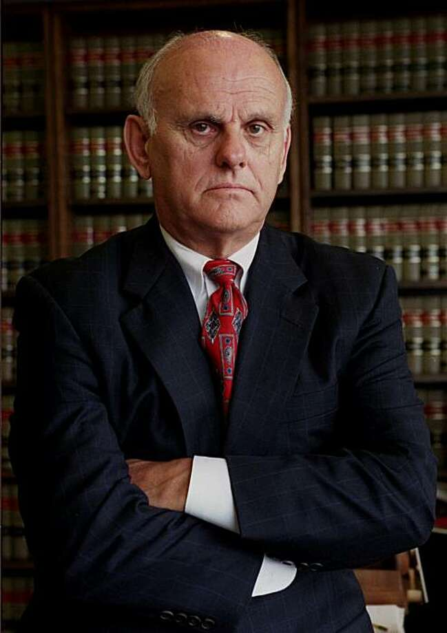 U.S. District Judge John C. Coughenour, seen here in his temporary chambers in Los Angeles Friday, March 23, 2001, is currently presiding over the federal trial of Algerian Ahmed Ressam, who is accused of smuggling bomb-making materials into Seattle in an alleged attempt to target U.S. sites during the millennium celebrations. Coughenour, who is based in Seattle, is hearing the case in Los Angeles after the trial was moved from Seattle on a change of venue order due to too much pretrial publicity in Washington state. (AP Photo/Rene Macura) Photo: Rene Macura, AP