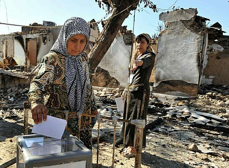 Ethnik Uzbek women vote in a yard of their burned out and destroyed house during a referendum in Osh on June 27, 2010. Kyrgyzstan's interim leaders on June 27 hailed a strong turnout in a referendum on a new constitution, held in defiance of warnings thepoll risked inflaming ethnic tensions after deadly clashes. The interim authorities have defiantly pressed ahead with the vote despite horrific clashes between minority Uzbeks and majority Kyrgyz earlier this month that killed hundreds and sparked fears the country faced collapse. Photo: Victor Drachev, AFP/Getty Images