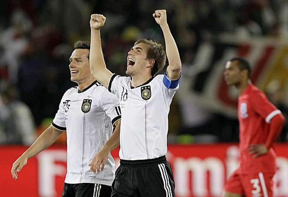 Germany's Philipp Lahm, second from left, and Germany's Piotr Trochowski, left, celebrate following the World Cup round of 16 soccer match between Germany and England at Free State Stadium in Bloemfontein, South Africa, Sunday, June 27, 2010. Germany defeated England 4-1, thereby advancing to the quarterfinals. Photo: Kirsty Wigglesworth, AP