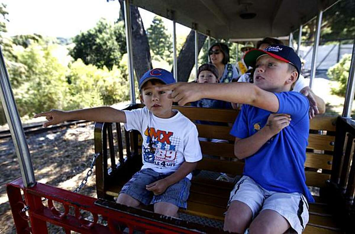 Six-year-old Mitchell Trimmer (left) and his brother Carson, 8, point out emus and wallaroos while riding the Outback Express Adventure Train in the new Wild Australia exhibit at the Oakland Zoo in Oakland, Calif., on Thursday, July 1, 2010.