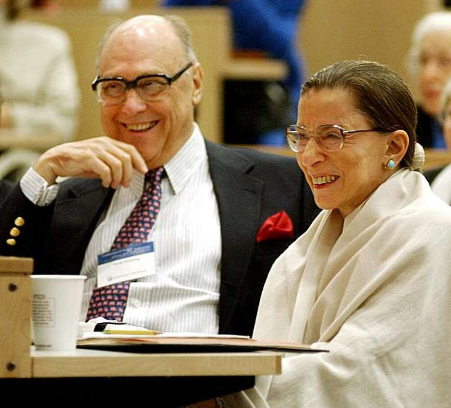 FILE - In this Sept. 12, 2003 file photo, Supreme Court Justice Ruth Bader Ginsburg, right, laughs with her husband Martin as they listen to Justice Stephen Breyer speak at Columbia Law School. The occasion celebrated the 10th anniversary of her appointment to the Supreme Court of the United States. Photo: Ed Bailey, AP