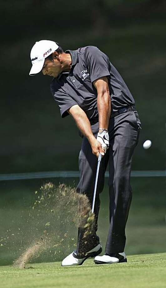 Arjun Atwal hits his second shot on the 18th hole during the first round of the AT&T National golf tournament at the Aronimink Golf Club, Thursday, July 1, 2010, in Newtown Square, Pa. Photo: Michael Bryant, AP