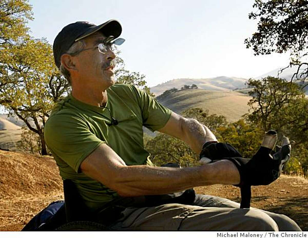 Bob Coomber of Livermore puts on his well worn gloves, showing his muscular forearms as he heads up Miwok Trail in Morgan Territory Regional Park near Livermore on October 26, 2008. Day 2 of a 4 day trek along the Diablo Regional Trail.