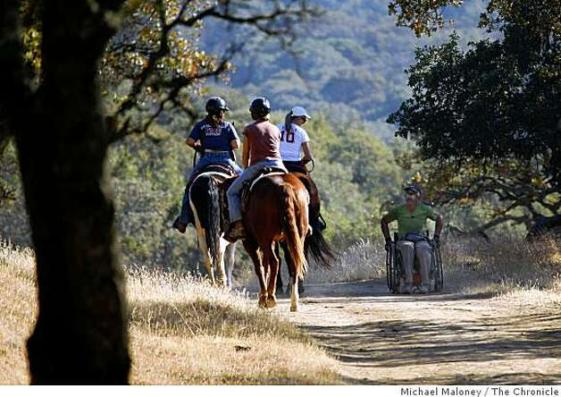 Coomber talks to some equestrians in Morgan Territory Regional Park on the second day of his four-day trek. Photo: Michael Maloney, The Chronicle