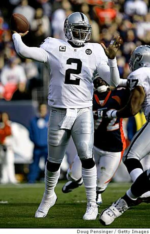 DENVER - NOVEMBER 23:  Quarterback JaMarcus Russell #2 of the Oakland Raiders delivers a pass against the Denver Broncos during week 12 NFL action at Invesco Field at Mile High on November 23, 2008 in Denver, Colorado.  (Photo by Doug Pensinger/Getty Images) Photo: Doug Pensinger, Getty Images