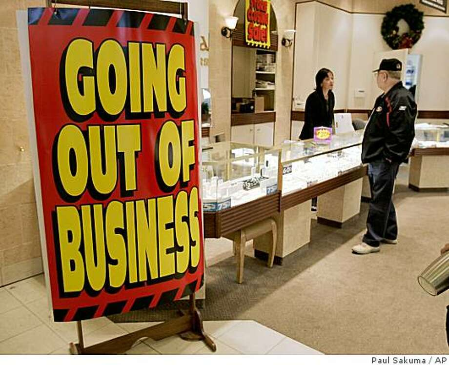 A sale sign is posted at jewlery store in Daly City, Calif., Monday, Nov. 24, 2008. The economy took a tumble in the summer that was worse than first thought as American consumers throttled back their spending by the most in 28 years, further proof the country is almost certainly in the throes of a painful recession. (AP Photo/Paul Sakuma) Photo: Paul Sakuma, AP