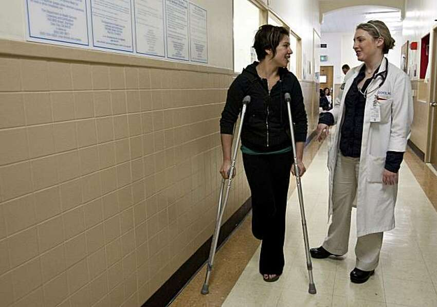 Elana Salzman, a member of the Healthy San Francisco program, speaks with her doctor Evie Precechtil after coming to the urgent care clinic at San Francisco General Hospital with a foot injury in San Francisco, Calif., on Monday, March 22, 2010.