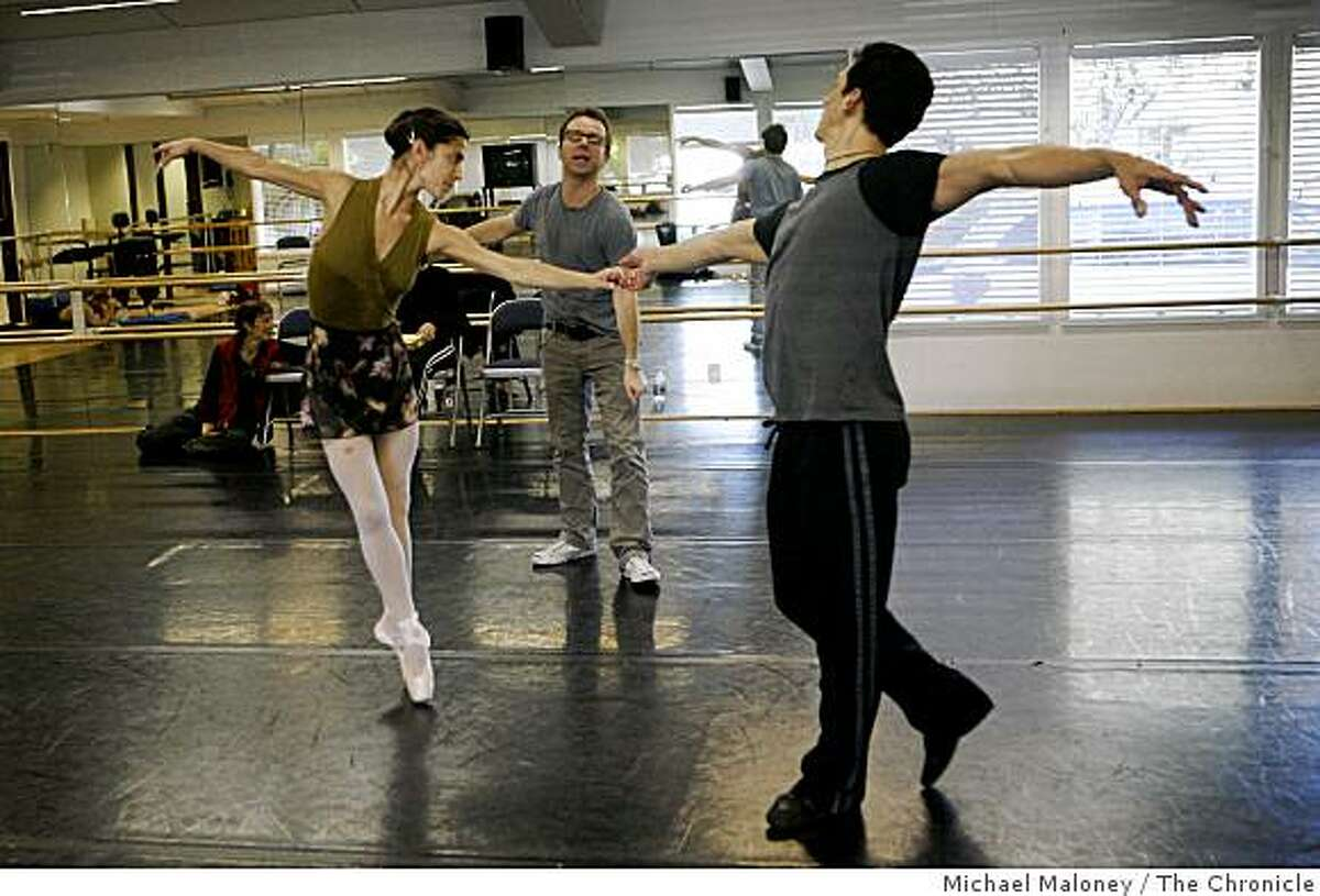 Former SF Ballet dancer, Christopher Stowell who now directs the Portland Ballet, works with dancers Jenna McClintock, left, and David Fonnegra, right, as they rehearse for