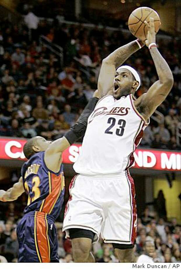 Cleveland Cavaliers' LeBron James (23) soars for a dunk over Golden State Warriors' C.J. Watson in the second quarter of an NBA basketball game Friday, Nov. 28, 2008, in Cleveland.  (AP Photo/Mark Duncan) Photo: Mark Duncan, AP