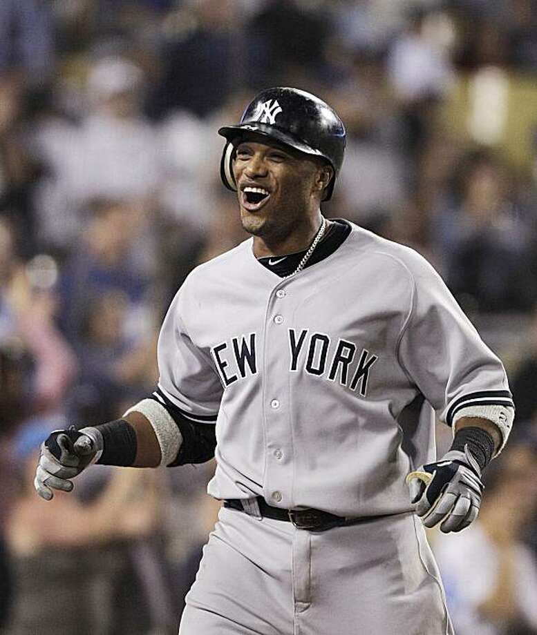 New York Yankees' Robinson Cano celebrates after hitting a two-run home run to lead the game against the Los Angeles Dodgers during the 10th inning of a baseball game in Los Angeles, Sunday, June 27, 2010. Photo: Jae C. Hong, AP