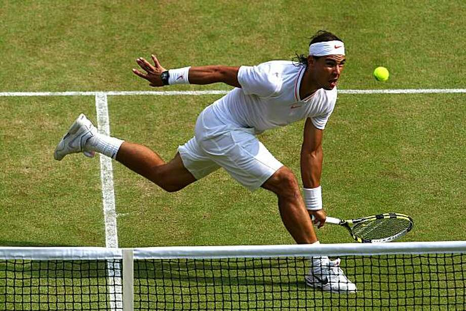 LONDON, ENGLAND - JUNE 26:  Rafael Nadal of Spain in action during his match against Philip Petzschner of Germany on Day Six of the Wimbledon Lawn Tennis Championships at the All England Lawn Tennis and Croquet Club on June 26, 2010 in London, England. Photo: Julian Finney, Getty Images
