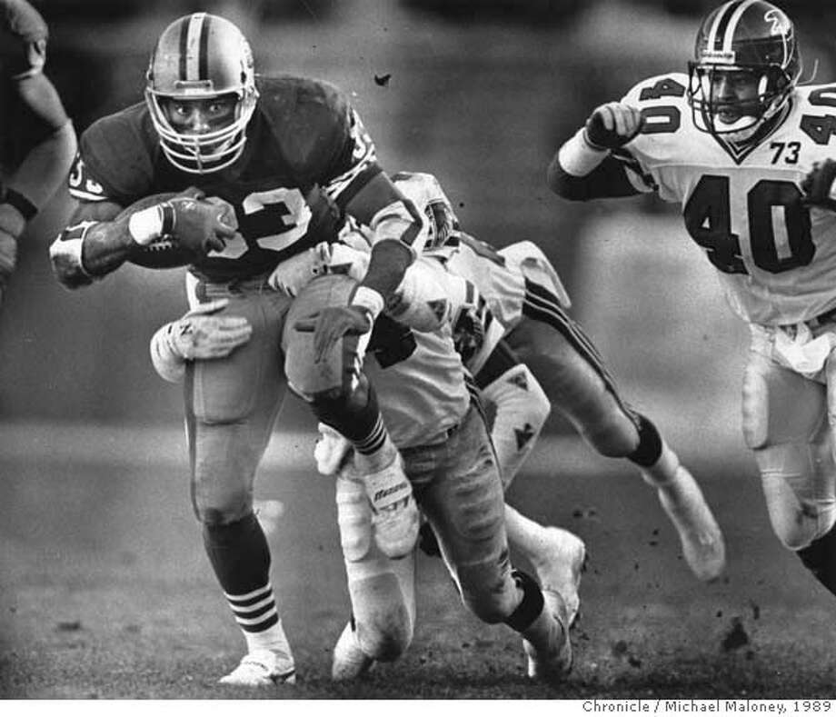 CRAIG-03DEC1989-MALONEY - Roger Craig drags tacklers with him on his way upfield, on Dec. 3, 1989, in Atlanta. Photo by Mike Maloney Photo: Mike Maloney