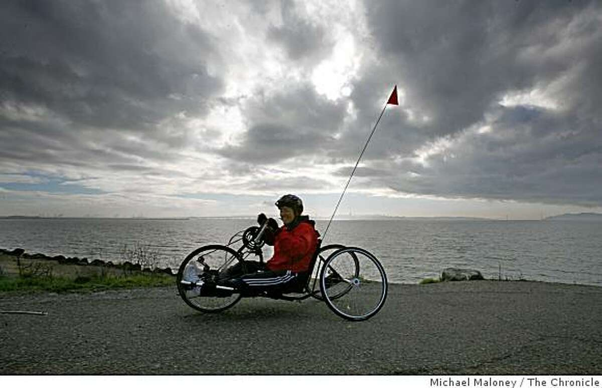 Joy Dryden, 59 of Sausalito, rides her bike path at Cesar Chavez State Park.