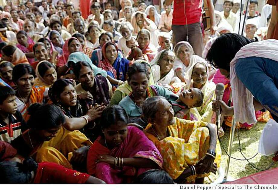 Bidya Marande, in a yellow sari, tells an audience of lower caste residents in Jharkhand state how she never worked for the massive government program but that her name was used nonetheless, allowing unscrupulous contractors to count her and receive payment on her behalf. Photo: Daniel Pepper, Special To The Chronicle