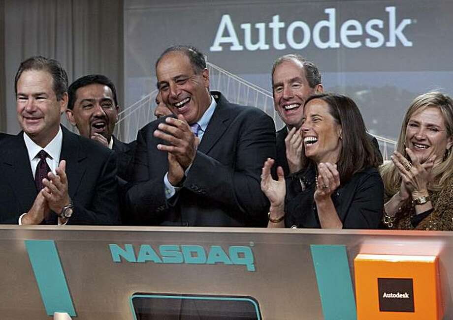 """Carl Bass, president and chief executive officer of Autodesk Inc., center, takes part in ringing the Nasdaq opening bell remotely with Adena Friedman, chief financial officer of NASDAQ OMX Group, second from right, at the Autodesk office in San Francisco, California, U.S., on Thursday, June 24, 2010. Autodesk Inc., maker of software used in bridge design and the special effects in the movie """"Avatar,"""" boosted the lower end of its second-quarter profit and sales forecasts, citing rising demand for its products. Photographer: David Paul Morris/Bloomberg *** Local Caption *** Carl Bass; Adena Friedman Photo: David Paul Morris, Bloomberg"""