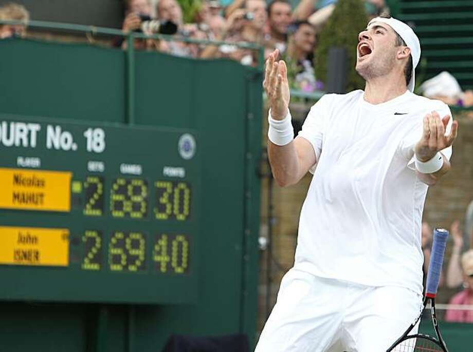 John Isner of the US reacts as he defeats France's Nicolas Mahut, in their epic men's singles match at the All England Lawn Tennis Championships at Wimbledon, Thursday, June 24, 2010. Photo: Alastair Grant, AP
